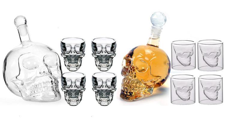 Бутылка и бокалы в виде черепов